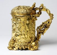 Cylindrical tankard, the base with applied grapevine and dolphin feet,