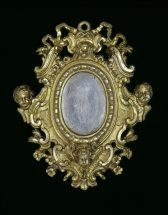 Frame for a miniature: silver gilt with rococo scrolls and cherubs.
