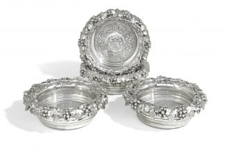 A set of four George IV silver wine bottle coasters, Benjamin Smith, London, 1820