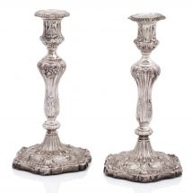 A pair of George III silver candlesticks by J. Roberts & Co., Sheffield 1812