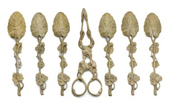 A set of six George III silver-gilt teaspoons and a pair of sugar tongs, one spoon stamped 'SH', otherwise unmarked, circa 1820